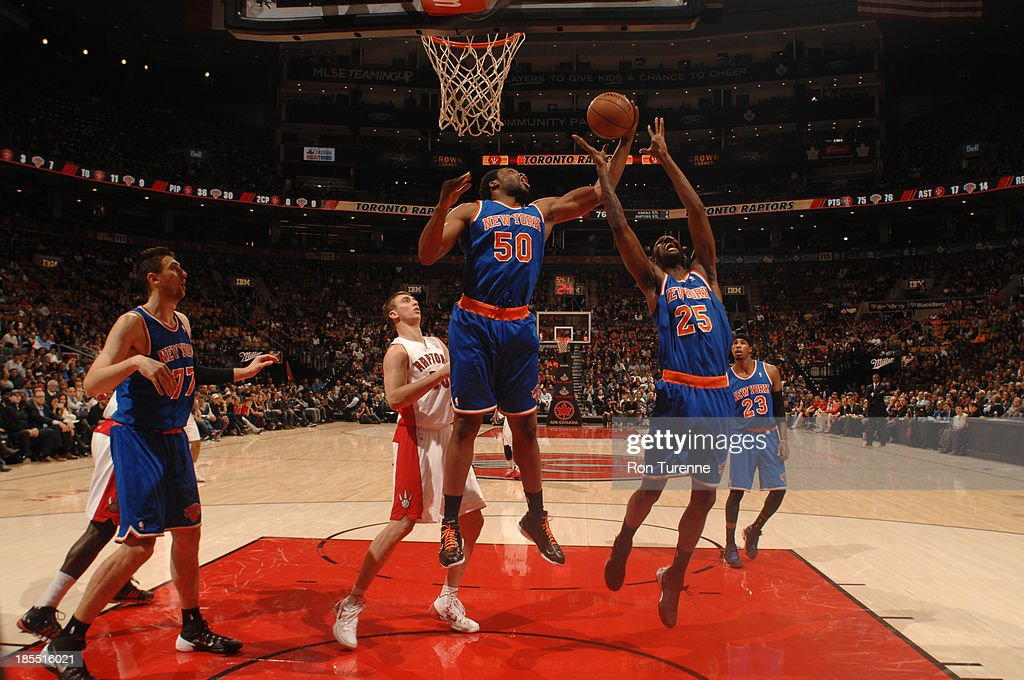 <a gi-track='captionPersonalityLinkClicked' href=/galleries/search?phrase=Ike+Diogu&family=editorial&specificpeople=556338 ng-click='$event.stopPropagation()'>Ike Diogu</a> #50 of the New York Knicks grabs a rebound against the rebound against the Toronto Raptors during the game on October 21, 2013 at the Air Canada Centre in Toronto, Ontario, Canada.