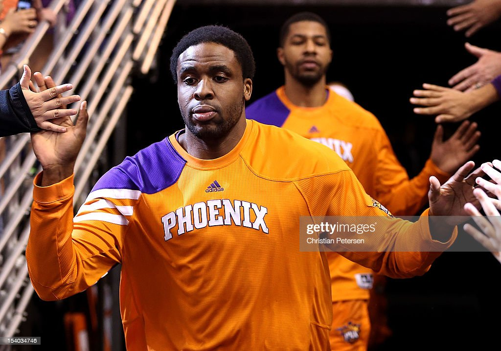 Ike Diogu of the Phoenix Suns runs out onto the court before the preseason NBA game against the Portland Trail Blazers at US Airways Center on...