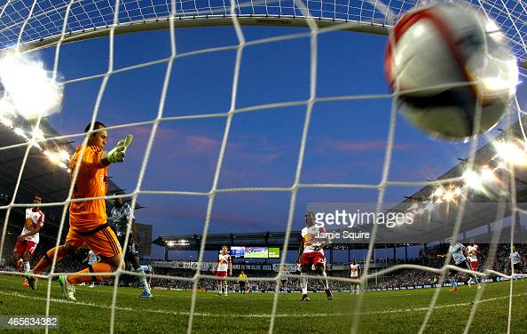 Ike Opara of Sporting KC scores as goalkeeper Luis Robles of New York Red Bulls defends during the game at Sporting Park on March 8 2015 in Kansas...