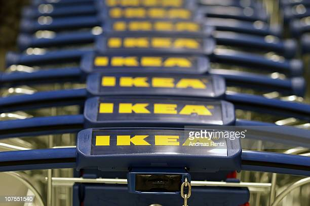 Ikea shopping carts stand in line during an opening ceremony at the 4th Ikea chain store in Berlin Lichtenberg on December 13 2010 in Berlin Germany...