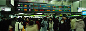 Commuters race between railway platforms to catch trains in the subway