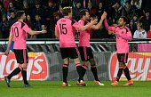 Ikechi Anya of Scotland celebrates scoring with his teammates during the friendly football match between the Czech Republic and Scotland at the Arena...