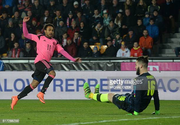 Ikechi Anya of Scotland scores past Czech goalkeeper Tomas Koubek during the friendly football match between the Czech Republic and Scotland at the...