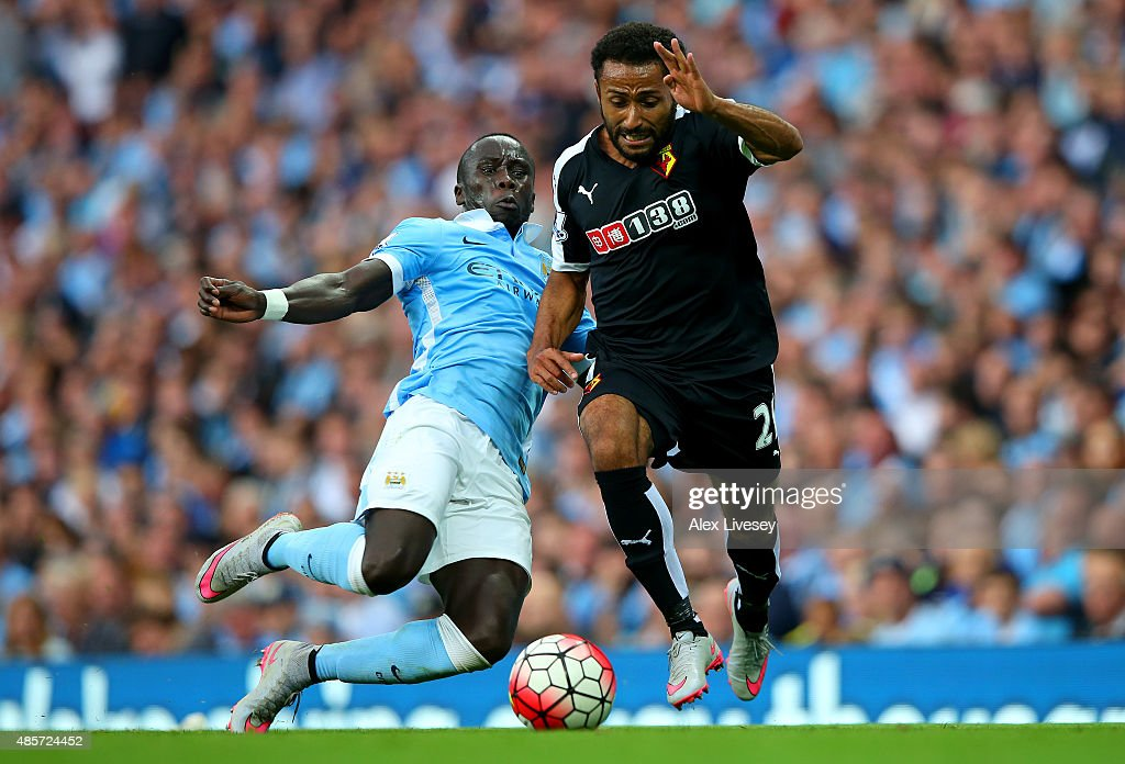 Ikechi Anya of Watford and Bacary Sagna of Manchester City compete for the ball during the Barclays Premier League match between Manchester City and Watford at Etihad Stadium on August 29, 2015 in Manchester, England.