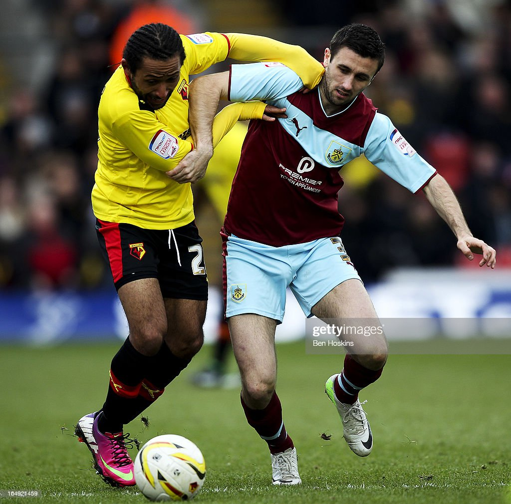 Ikechi Anya of Watford battles with Danny Ings of Burnley during the npower Championship match between Watford and Burnley at Vicarage Road on March 29, 2013 in Watford, England.