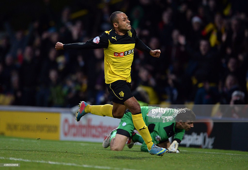 Ikechi Anya of Watford celebrates after scoring goal prior to it being disallowed for being offside during the the Sky Bet Championship match between Watford and Sheffield Wednesday at Vicarage Road on December 14, 2013 in Watford, England,