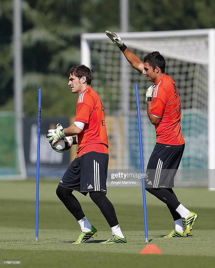 <a gi-track='captionPersonalityLinkClicked' href=/galleries/search?phrase=Iker+Casillas&family=editorial&specificpeople=215446 ng-click='$event.stopPropagation()'>Iker Casillas</a> (L) and Antonio Adan of Real Madrid exercise during a training session at Valdebebas training ground on August 17, 2013 in Madrid, Spain.