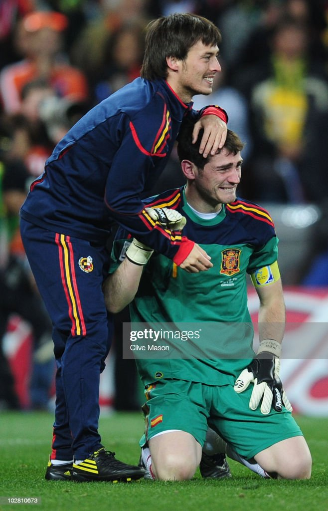 Iker Casillas and David Silva of Spain celebrate victory at the final whistle during the 2010 FIFA World Cup South Africa Final match between Netherlands and Spain at Soccer City Stadium on July 11, 2010 in Johannesburg, South Africa.
