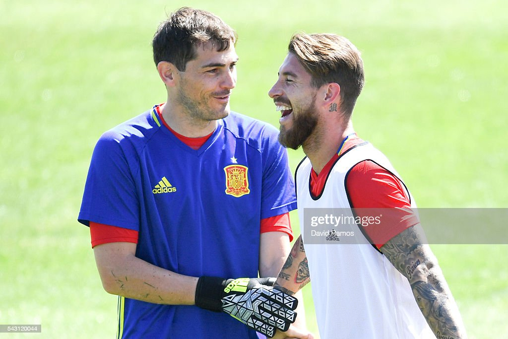 <a gi-track='captionPersonalityLinkClicked' href=/galleries/search?phrase=Iker+Casillas&family=editorial&specificpeople=215446 ng-click='$event.stopPropagation()'>Iker Casillas</a> (L) and Sergio Ramos of Spain share a joke during a training session ahead of their UEFA Euro 2016 round of 16 match against Italy at Complexe Sportif Marcel Gaillard on June 26, 2016 in La Rochelle, France.