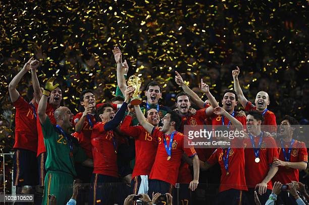 Iker Casillas captain of Spain and the Spain team celebrate victory with the World Cup trophy during the 2010 FIFA World Cup South Africa Final match...