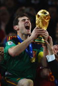 Iker Casillas captain of Spain celebrates victory with the World Cup trophy during the 2010 FIFA World Cup South Africa Final match between...