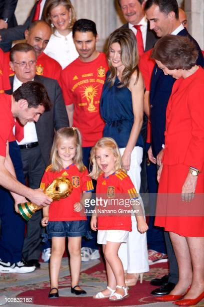 Iker Casillas captain of Spain hands the World Cup to Princess Leonor of Spain and Princess Sofia of Spain while Princess Letizia of Spain Prince...