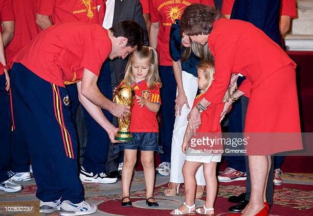 Iker Casillas captain of Spain hands the World Cup to Princess Leonor of Spain and Princess Sofia of Spain while Princess Letizia of Spain and Queen...