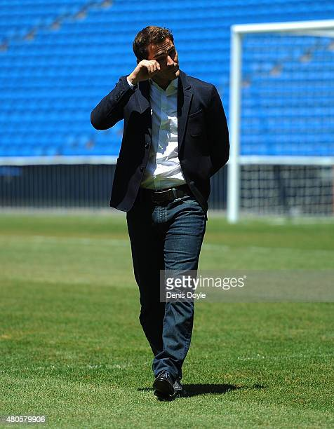 Iker Casillas is overcome with emotion while waving to fans at the Santiago Bernabeu stadium after attending a press conference to announce that he...