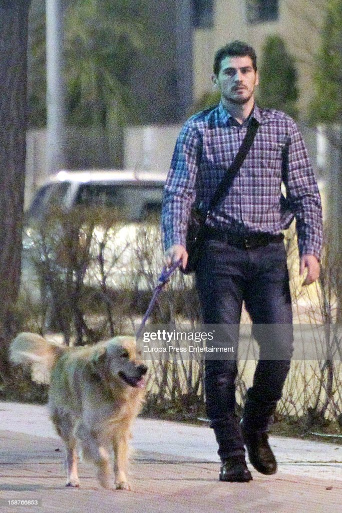 Iker Casillas is seen going for a walk with his pet dog on December 27, 2012 in Madrid, Spain.