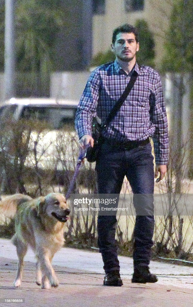 <a gi-track='captionPersonalityLinkClicked' href=/galleries/search?phrase=Iker+Casillas&family=editorial&specificpeople=215446 ng-click='$event.stopPropagation()'>Iker Casillas</a> is seen going for a walk with his pet dog on December 27, 2012 in Madrid, Spain.