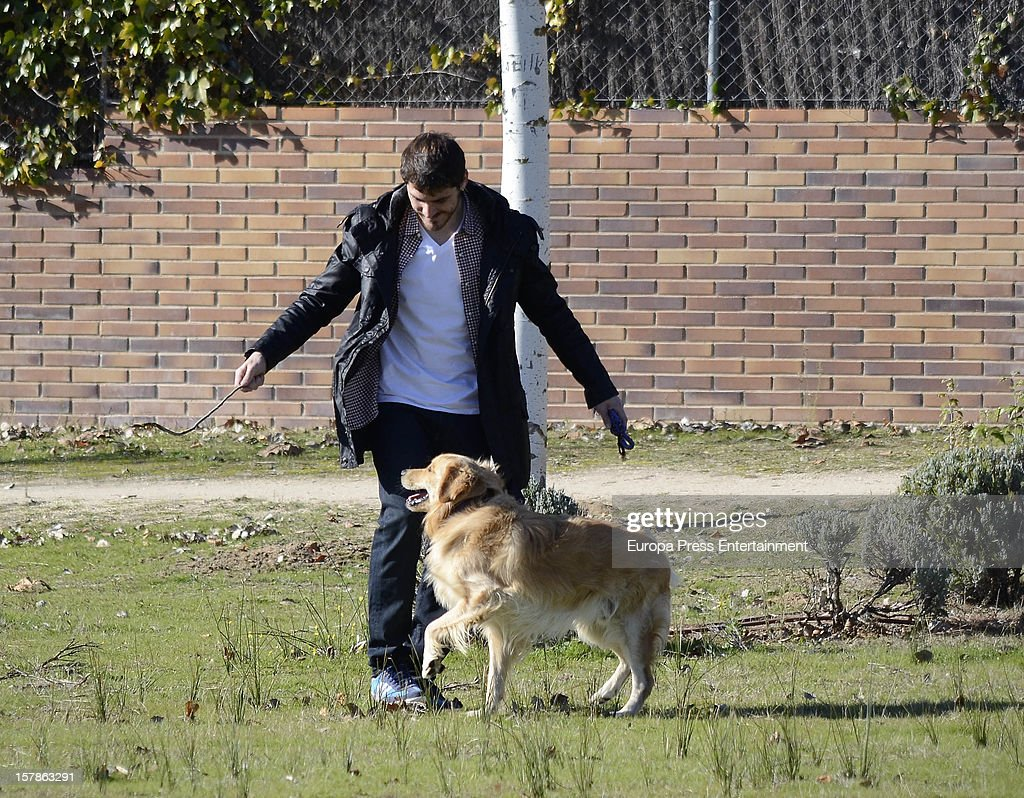 Iker Casillas is seen with his pet dog on December 6, 2012 in Madrid, Spain.
