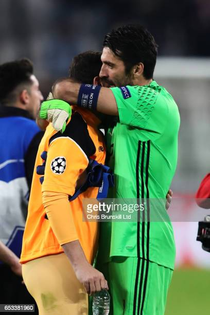 Iker Casillas of FC Porto and Gianluigi Buffon of Juventus embrace at the end of the UEFA Champions League Round of 16 second leg match between...