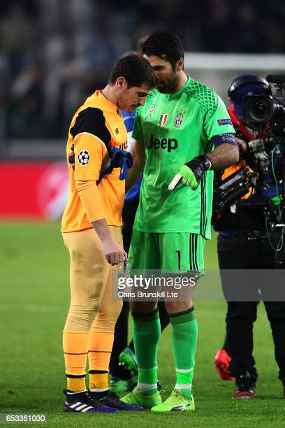 Iker Casillas of FC Porto and Gianluigi Buffon of Juventus speak at the end of the UEFA Champions League Round of 16 second leg match between...