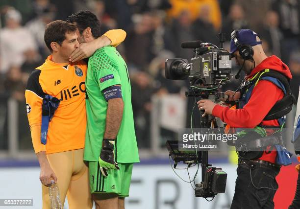 Iker Casillas of FC Porto embraces Gianluigi Buffon of Juventus FC at the end of the UEFA Champions League Round of 16 second leg match between...