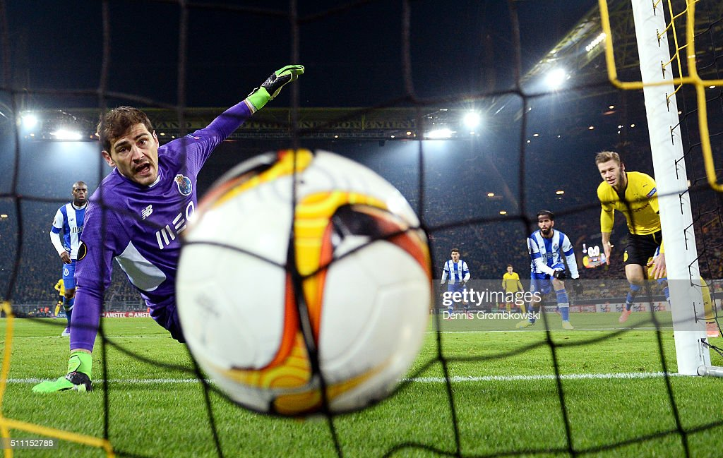 <a gi-track='captionPersonalityLinkClicked' href=/galleries/search?phrase=Iker+Casillas&family=editorial&specificpeople=215446 ng-click='$event.stopPropagation()'>Iker Casillas</a> of FC Porto watches the ball at the back of the net as <a gi-track='captionPersonalityLinkClicked' href=/galleries/search?phrase=Lukasz+Piszczek&family=editorial&specificpeople=4380352 ng-click='$event.stopPropagation()'>Lukasz Piszczek</a> (R) of Borussia Dortmund heads the ball to score his team's first goal during the UEFA Europa League round of 32 first leg match between Borussia Dortmund and FC Porto at Signal Iduna Park on February 18, 2016 in Dortmund, Germany.