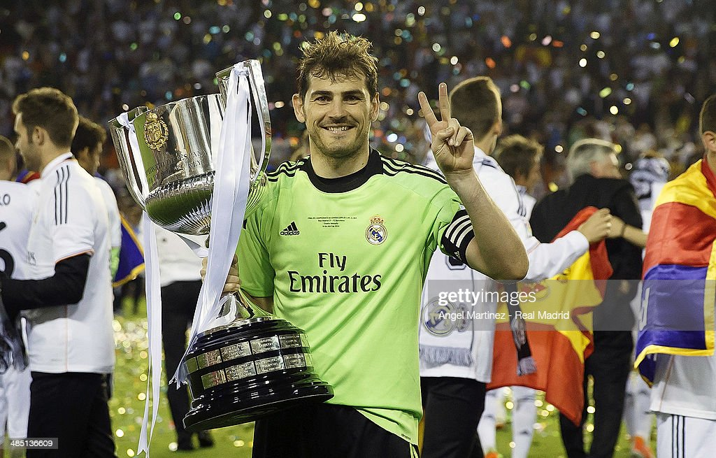 Iker Casillas of Real Madrid celebrates with the trophy after the Copa del Rey Final between Real Madrid and Barcelona at Estadio Mestalla on April 16, 2014 in Valencia, Spain.