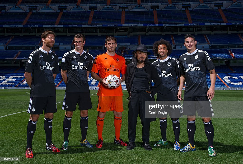 Iker Casillas of Real Madrid CF and teammates James Rodriguez Xabi Alonso Gareth Bale and Marcelo of Real Madrid with designer Yohji Yamamoto during...