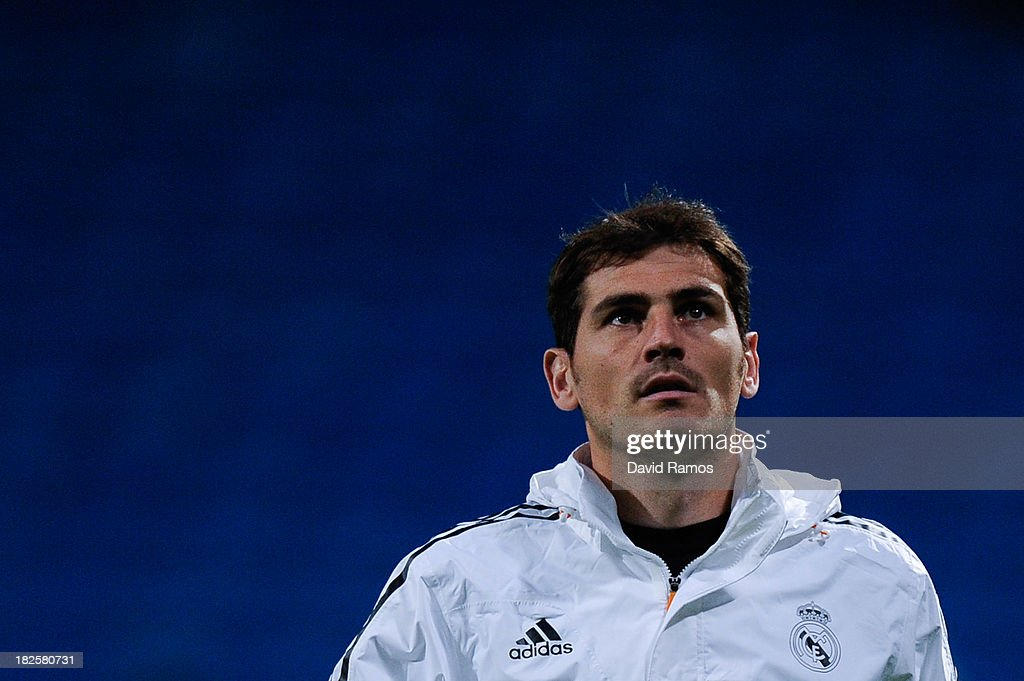 Iker Casillas of Real Madrid CF looks on during the warm up prior to the La Liga match between Real Madrid CF and Club Atletico de Madrid at Bernabeu on September 28, 2013 in Madrid, Spain.