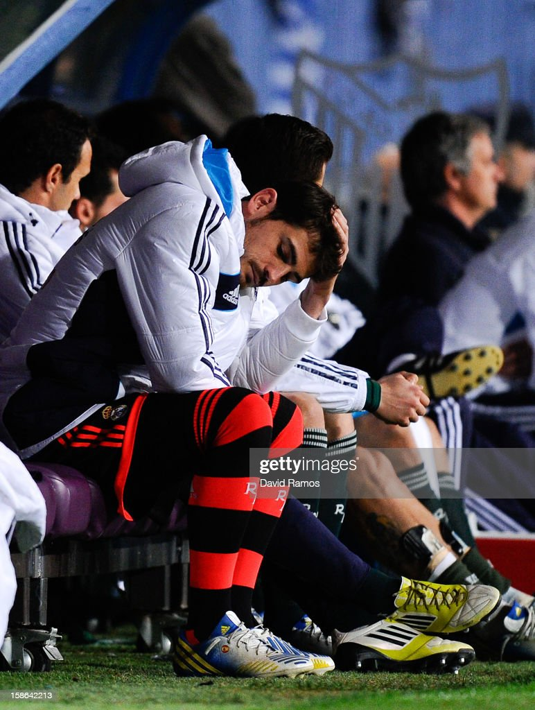 Iker Casillas of Real Madrid CF reacts dejected on the bench after Roque Santa Cruz of Malaga CF scored his team's third goal during the La Liga match between Malaga CF and Real Madrid CF at La Rosaleda Stadium on December 22, 2012 in Malaga, Spain.
