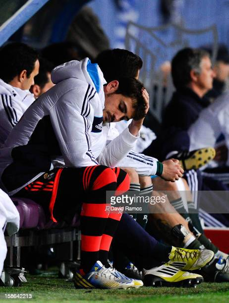 Iker Casillas of Real Madrid CF reacts dejected on the bench after Roque Santa Cruz of Malaga CF scored his team's third goal during the La Liga...