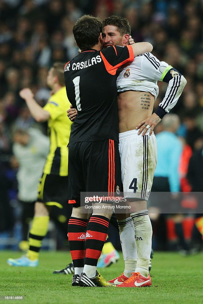 <a gi-track='captionPersonalityLinkClicked' href=/galleries/search?phrase=Iker+Casillas&family=editorial&specificpeople=215446 ng-click='$event.stopPropagation()'>Iker Casillas</a> of Real Madrid consoles teammate Sergio Ramos after the UEFA Champions League Semi Final Second Leg match between Real Madrid and Borussia Dortmund at Estadio Santiago Bernabeu on April 30, 2013 in Madrid, Spain.