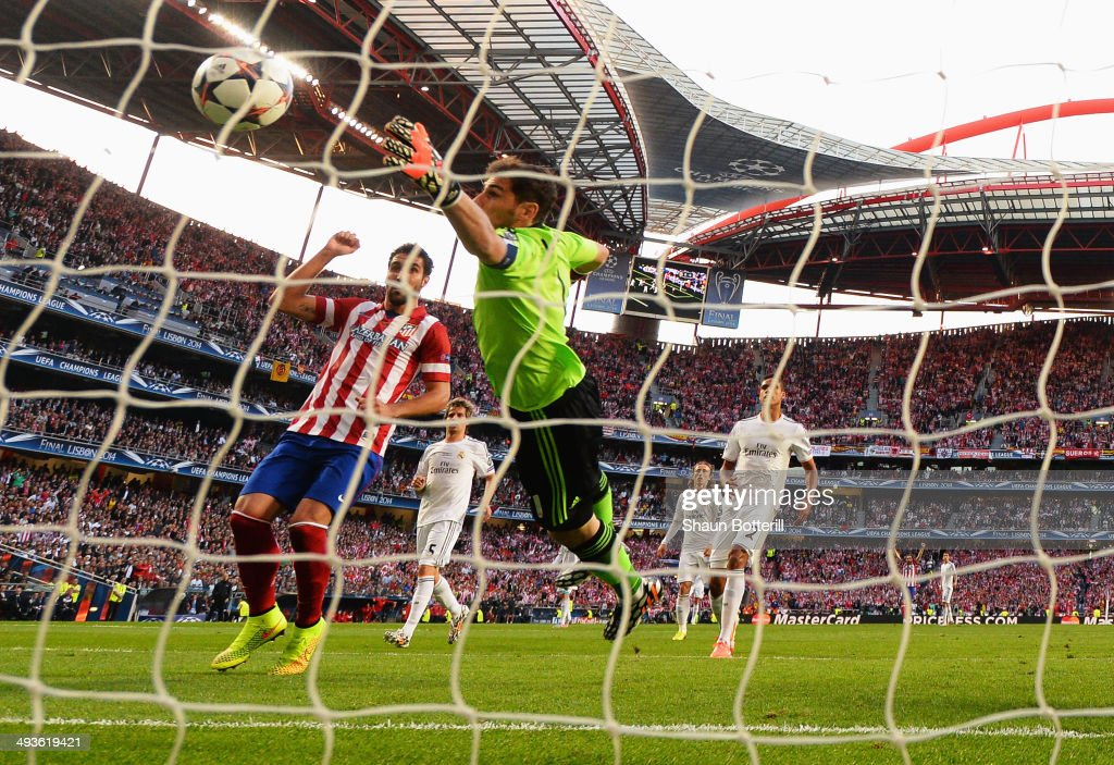 <a gi-track='captionPersonalityLinkClicked' href=/galleries/search?phrase=Iker+Casillas&family=editorial&specificpeople=215446 ng-click='$event.stopPropagation()'>Iker Casillas</a> of Real Madrid fails to stop the ball headed in by Diego Godin of Club Atletico de Madrid (not pictured) for the first goal during the UEFA Champions League Final between Real Madrid and Atletico de Madrid at Estadio da Luz on May 24, 2014 in Lisbon, Portugal.