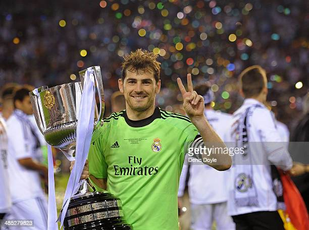 Iker Casillas of Real Madrid holds the Copa del Rey trophy after beating Barcelona in the Copa del Rey Final at Estadio Mestalla on April 16 2014 in...