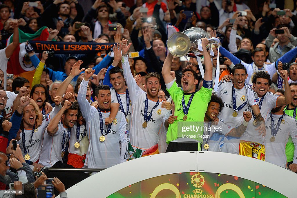 <a gi-track='captionPersonalityLinkClicked' href=/galleries/search?phrase=Iker+Casillas&family=editorial&specificpeople=215446 ng-click='$event.stopPropagation()'>Iker Casillas</a> of Real Madrid lifts the Champions League trophy during the UEFA Champions League Final between Real Madrid and Atletico de Madrid at Estadio da Luz on May 24, 2014 in Lisbon, Portugal.