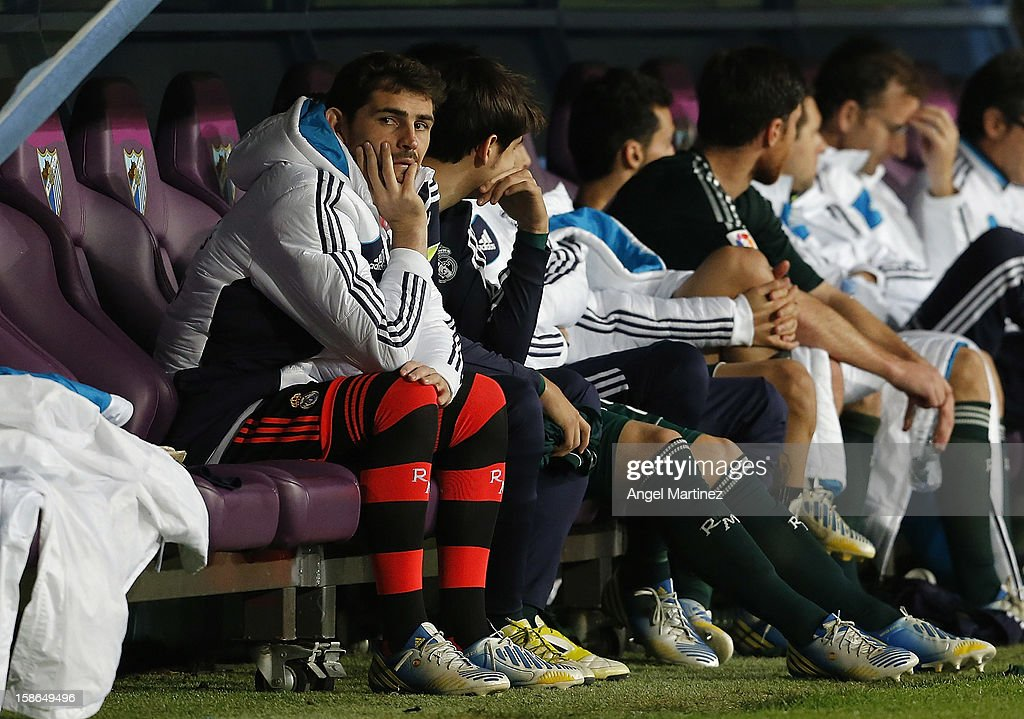 Iker Casillas (L) of Real Madrid looks on sit on the bench during the La Liga match between Malaga CF and Real Madrid at La Rosaleda Stadium on December 22, 2012 in Malaga, Spain.