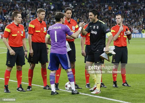Iker Casillas of Real Madrid shakes hands with Gianluigi Buffon of Juventus before the UEFA Champions League Group B match between Real Madrid and...