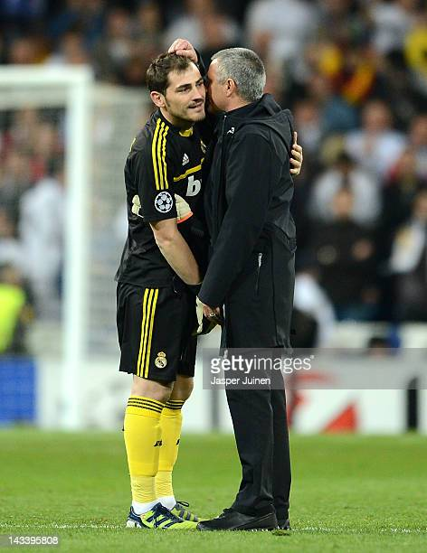 Iker Casillas of Real Madrid speaks to head coach Jose Mourinho of Real Madrid during the UEFA Champions League Semi Final second leg between Real...