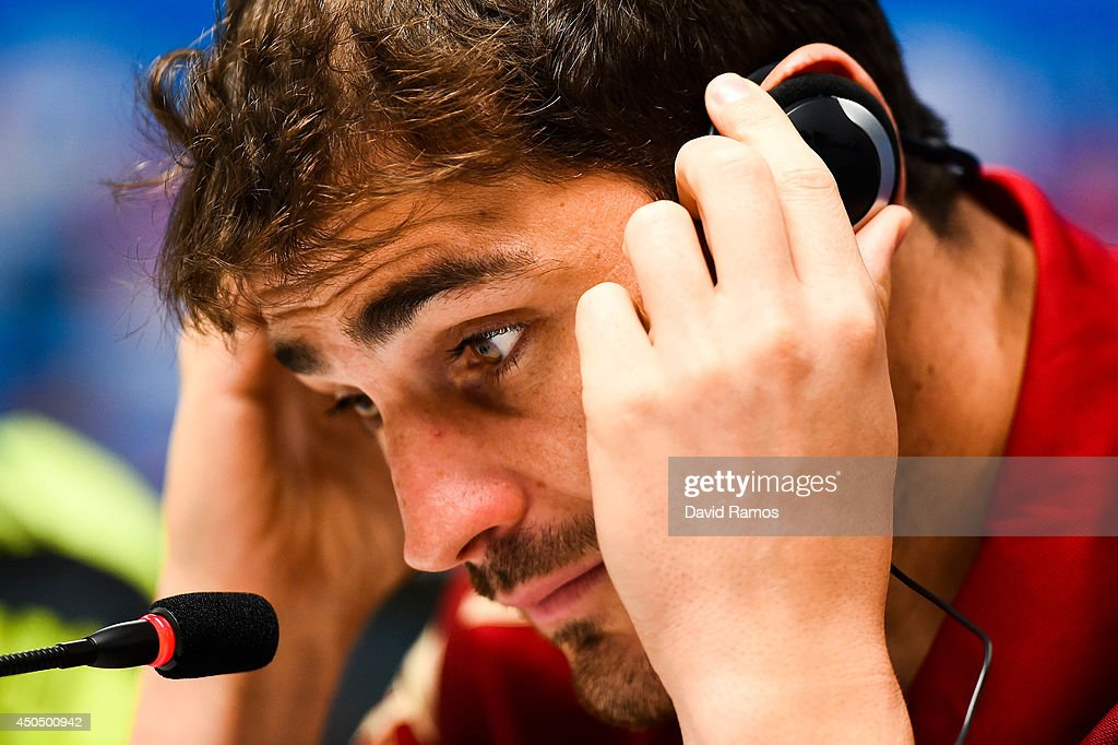Iker Casillas of Spain adjusts his headphones during the Spain press conference ahead the 2014 FIFA World Cup Group B match between Spain and Netherlands at Arena Fonte Nova on June 12, 2014 in Salvador, Brazil.