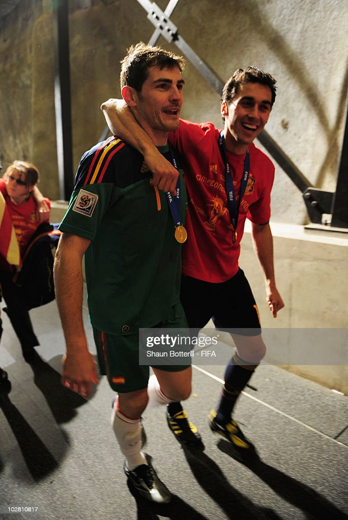 <a gi-track='captionPersonalityLinkClicked' href=/galleries/search?phrase=Iker+Casillas&family=editorial&specificpeople=215446 ng-click='$event.stopPropagation()'>Iker Casillas</a> of Spain and <a gi-track='captionPersonalityLinkClicked' href=/galleries/search?phrase=Alvaro+Arbeloa&family=editorial&specificpeople=3941965 ng-click='$event.stopPropagation()'>Alvaro Arbeloa</a> of Spain celebrate after the 2010 FIFA World Cup South Africa Final match between Netherlands and Spain at Soccer City Stadium on July 11, 2010 in Johannesburg, South Africa.
