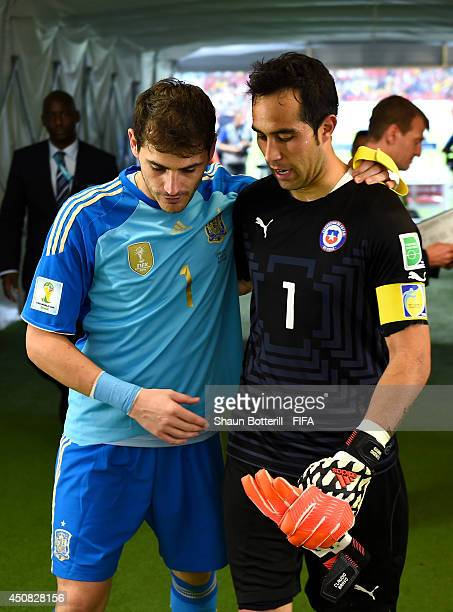 Iker Casillas of Spain and Claudio Bravo of Chile talk in the tunnel after the 2014 FIFA World Cup Brazil Group B match between Spain and Chile at...