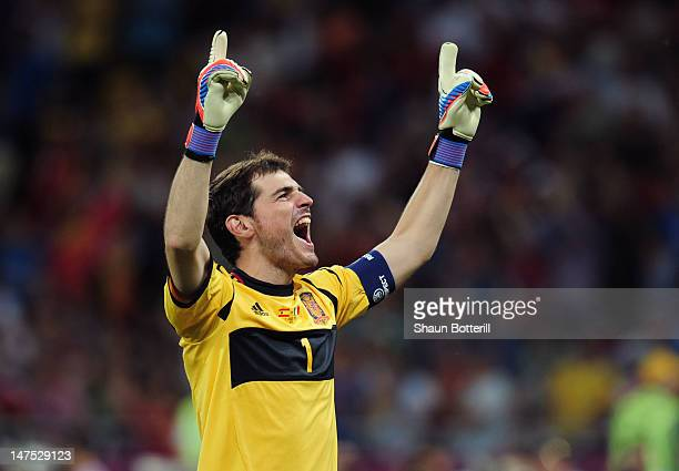 Iker Casillas of Spain celebrates after his teammate Fernando Torres scored their third goal during the UEFA EURO 2012 final match between Spain and...