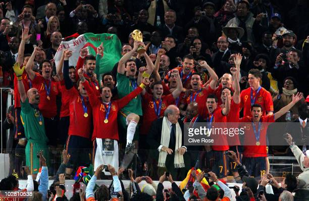 Iker Casillas of Spain celebrates lifting the World Cup with team mates during the 2010 FIFA World Cup South Africa Final match between Netherlands...