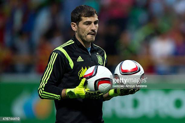 Iker Casillas of Spain holds a pair of balls during his warming up prior to start the international friendly match between Spain and Costa Rica at...