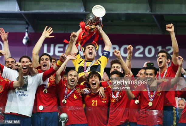 Iker Casillas of Spain lifts the trophy as he celebrates with teammates following victory in the UEFA EURO 2012 final match between Spain and Italy...