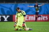 Iker Casillas of Spain looks dejected after the Netherlands second goal during the 2014 FIFA World Cup Brazil Group B match between Spain and...
