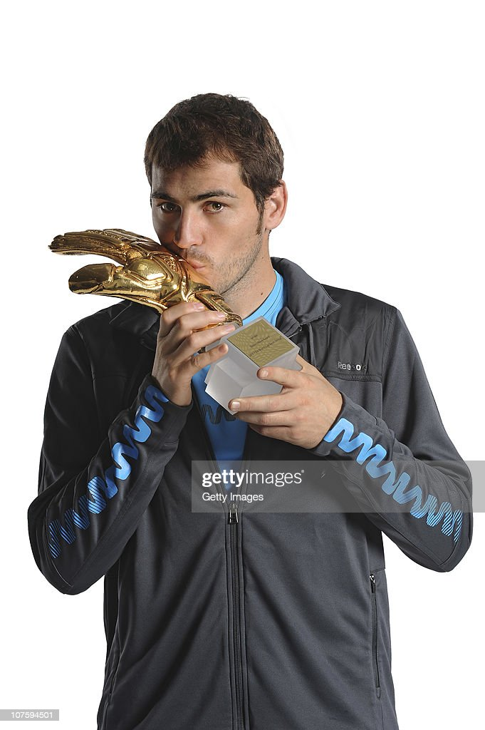 Iker Casillas of Spain poses with the adidas Golden Glove Winner Trophy at the adidas HQ on December 14, 2010 in Herzogenaurach, Germany.