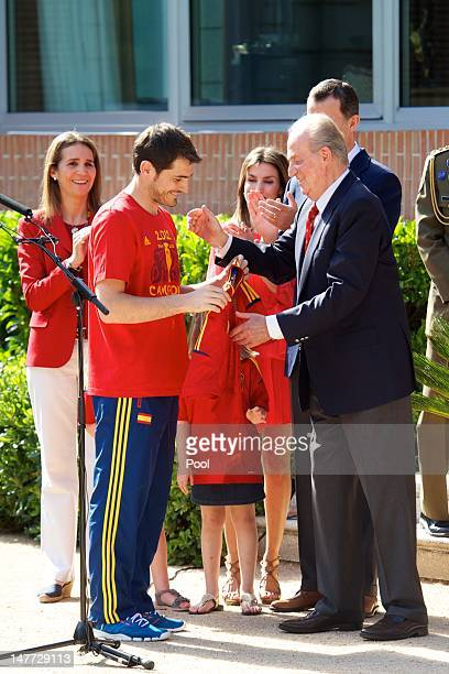 Iker Casillas of Spain presents King Juan Carlos I of Spain qith a replica shirt as the King receives members of Spain's victorious UEFA EURO 2012...