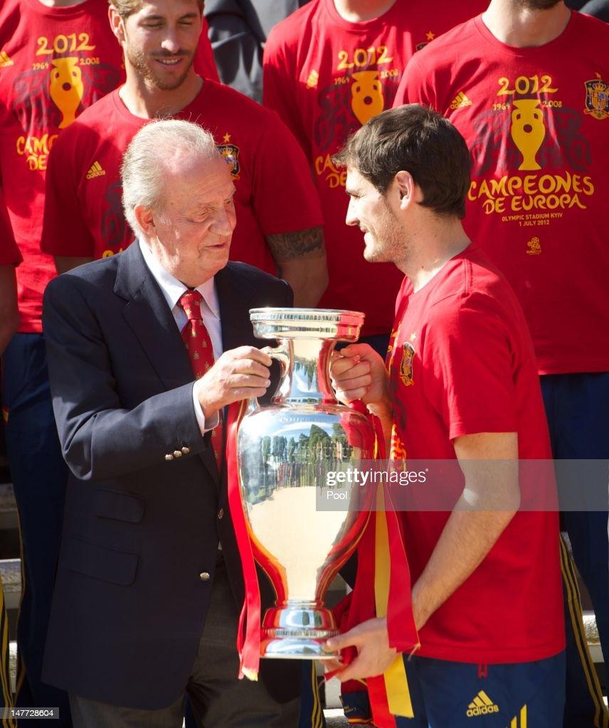 Iker Casillas (R) of Spain presents the UEFA EURO 2012 trophy to King Juan Carlos I of Spain at Zarzuela Palace on July 2, 2012 in Madrid, Spain.