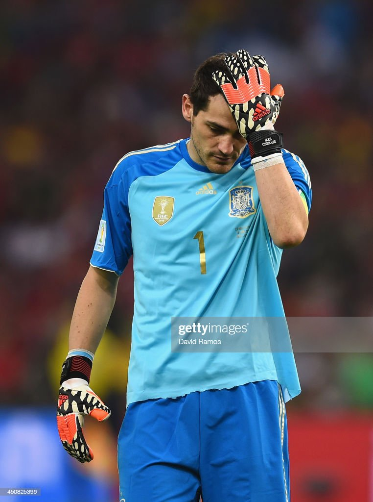 <a gi-track='captionPersonalityLinkClicked' href=/galleries/search?phrase=Iker+Casillas&family=editorial&specificpeople=215446 ng-click='$event.stopPropagation()'>Iker Casillas</a> of Spain reacts after a missed chance during the 2014 FIFA World Cup Brazil Group B match between Spain and Chile at Maracana on June 18, 2014 in Rio de Janeiro, Brazil.