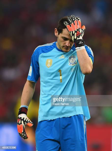 Iker Casillas of Spain reacts after a missed chance during the 2014 FIFA World Cup Brazil Group B match between Spain and Chile at Maracana on June...